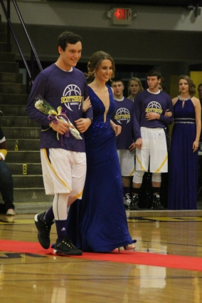 Photo by: Nicaila Mata --- Sophomore Marly McNeely walks with her escort Ben Hunley