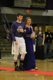 Photo by: Nicaila Mata --- Junior Kelsey Barrett walks with her escort, Bradley Whitler.
