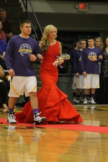 Photo by: Nicaila Mata --- Junior Emma Waskom, who was later crowned Homecoming Princess, walks with Taylor Funk.