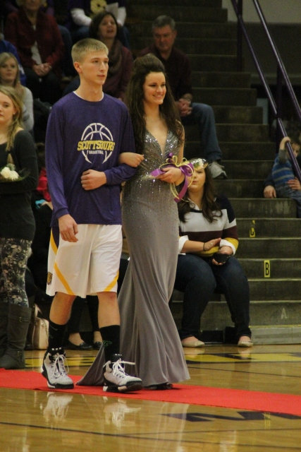 Photo by: Nicaila Mata --- Senior Emily Howser walks with her escort, Alex Wan.
