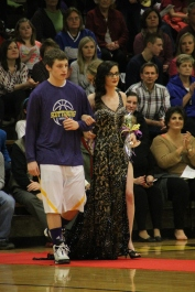 Photo by: Nicaila Mata --- Senior Ariel Robbins walks with her escort, Jimmy Neace.
