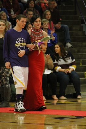 Photo by: Nicaila Mata --- Senior, and later Queen, Victoria Rone walks with her escort, Kyle Newton.