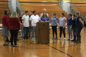 The Scottsburg HS choir, led by Brandon Visetchaisri (12), sing the national anthem